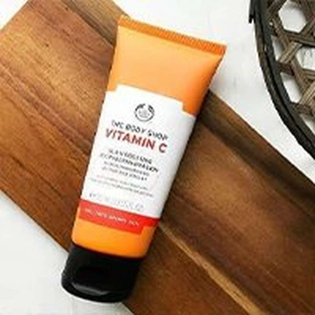 BODY SHOP VITAMIN C MICRODERMABRASION TUBE ON WOOD