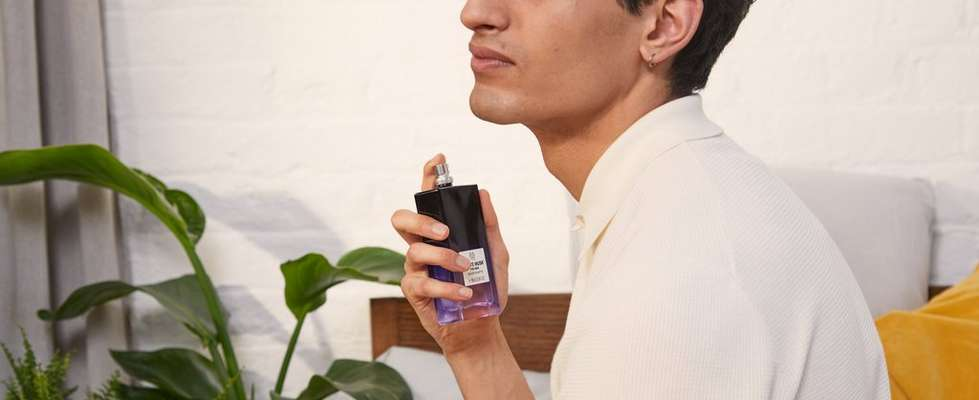 Man spraying The Body Shop White Musk Eau De Toilette