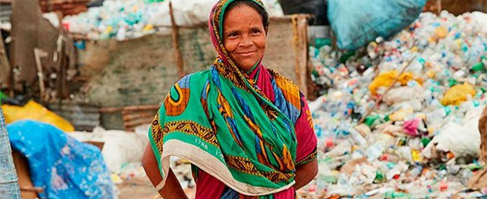 Woman working with plastic waste