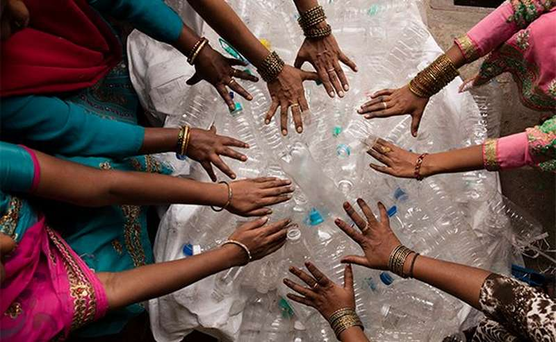 womens hands on plastic bottles