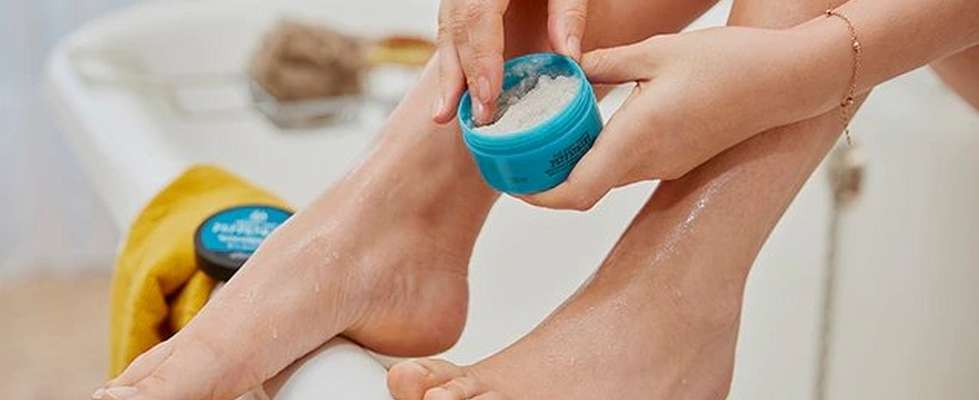 Applying foot scrub