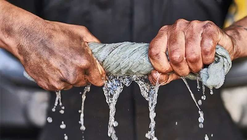 Man wringing water from cloth