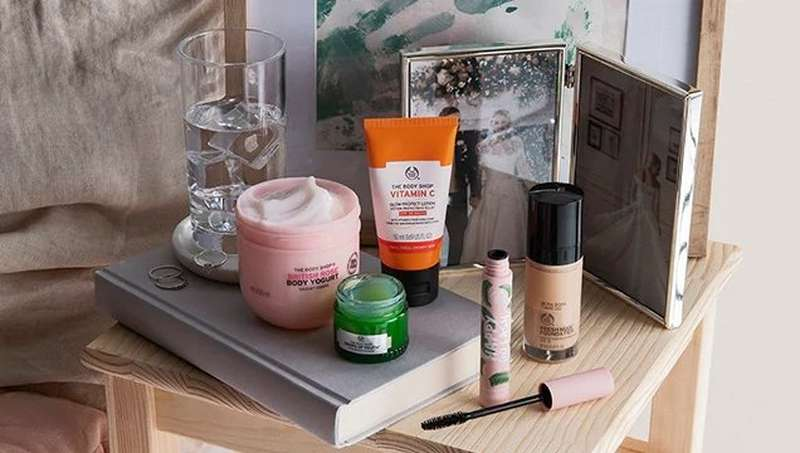 BODY SHOP PRODUCTS ON BEDSIDE TABLE